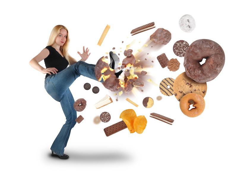Woman kicking sugary junk foods